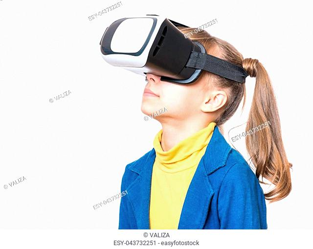 7d46930edb2c Happy little girl wearing virtual reality goggles watching movies or playing  video games