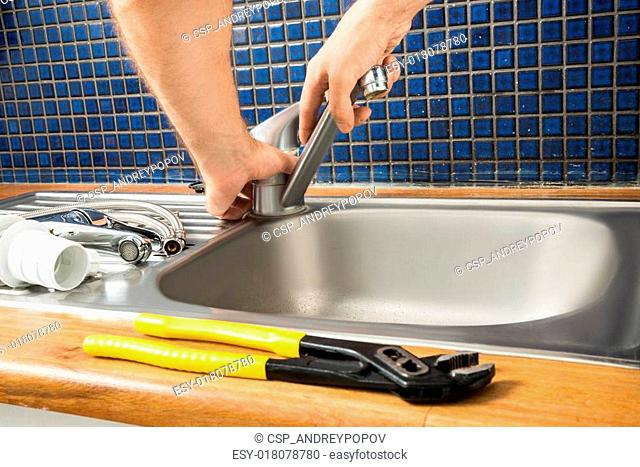 Plumber Fixing Tap