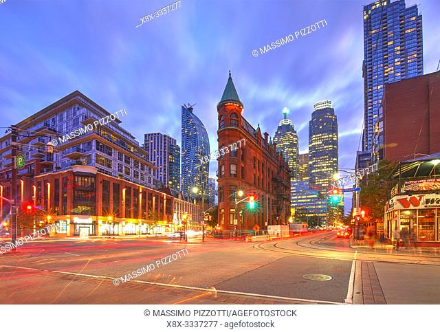 Gooderham Building, also known as the Flatiron Building, during the blue hour with light trails, Toronto, Canada