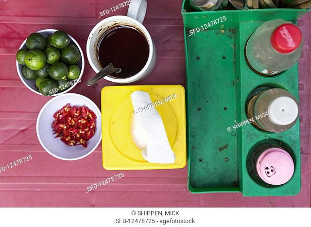 Seasonings on a table in Hanoi (Vietnam, Asia)
