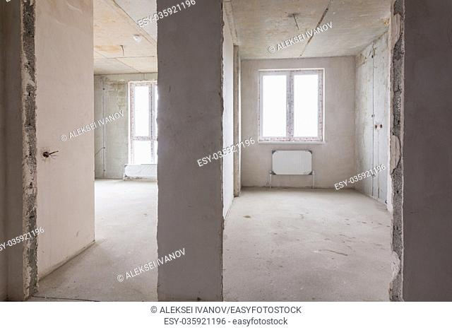 The layout of rooms and rooms in a new building, a view of two rooms and a partition between them