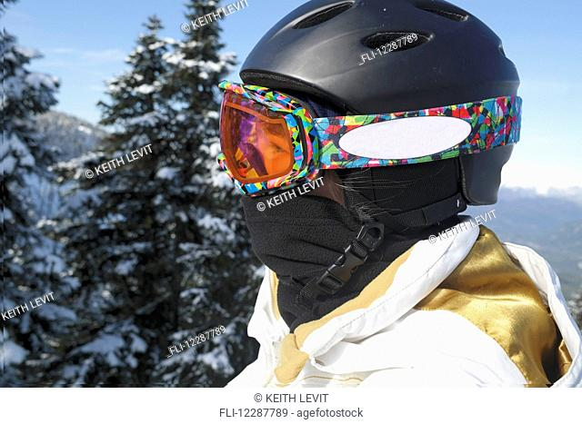 Close-up of skier in goggles and helmet; Whistler, British Columbia, Canada