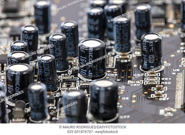 Close view of the main computer circuit board capacitors