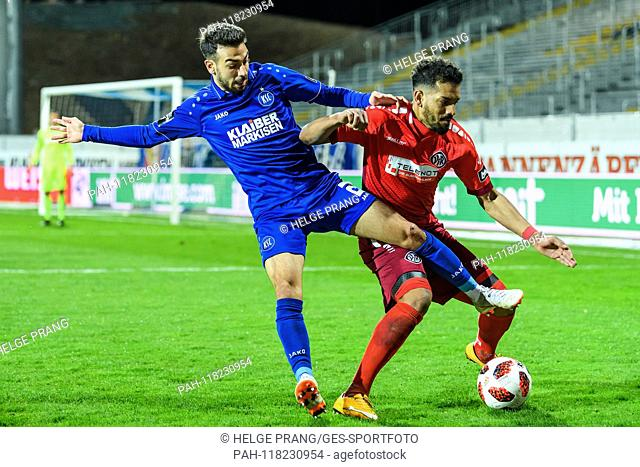 Burak Camoglu (KSC) duels with Royal-Dominique Fennell (VfR Aalen). GES / Soccer / 3. Liga: Karlsruher SC - VfR Aalen, 13.03