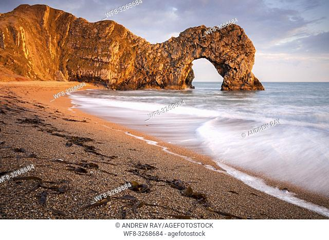 The natural sea arch at Durdle Door on Dorset's Jurassic Coast, bathed in late evening light in mid April