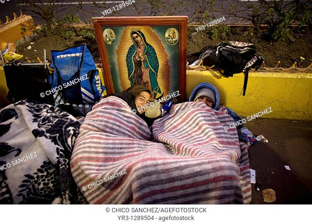 Pilgrims sleep in the street by an image of the Our Lady of Guadalupe virgin in Mexico City, December 11, 2010  Hundreds of thousands of Mexican pilgrims...