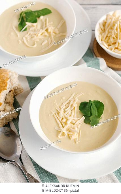 Bowls of cheese soup on table