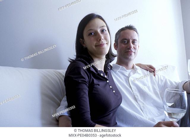 young couple enjoys wine