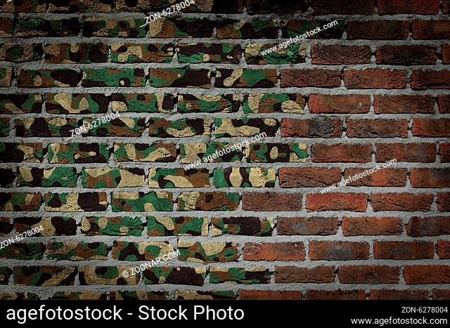 Dark brick wall texture - flag painted on wall - Army camouflage