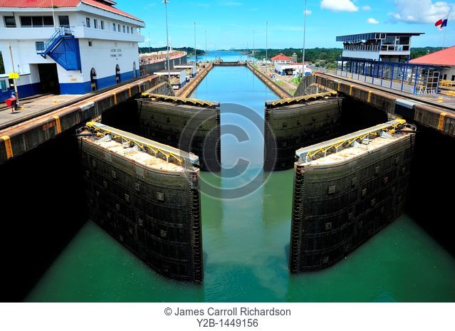 Panama Canal locks filling with water for ships passage, Panama