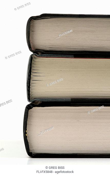 Close up Side View of Spines of books on White background
