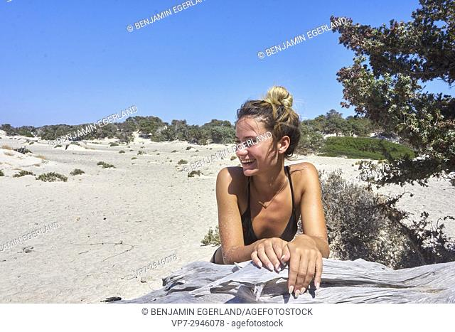 happy young woman enjoying summer. Dutch ethnicity. At holiday destination Chrissi Island, Crete, Greece