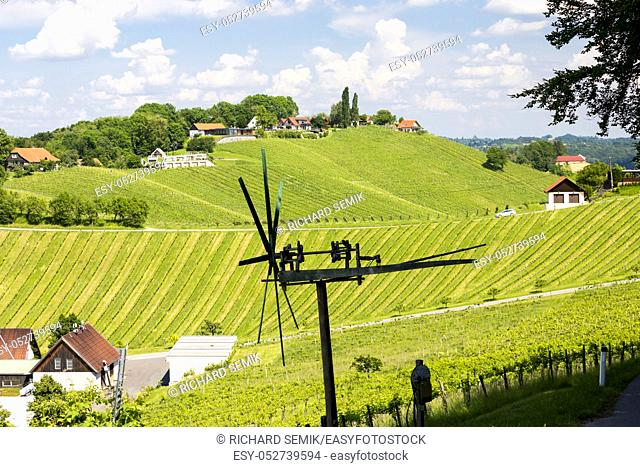 vineyard with windmill called klapotetz in south of Styria, Austria