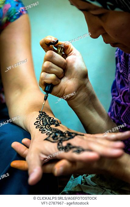Fes, Marocco, North Africa. Henna tattoo on hand for a tourist