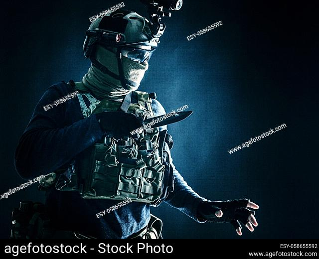 Special operations soldier, commando fighter, modern warfare combatant in combat uniform, helmet with night-vision, wearing mask and glasses