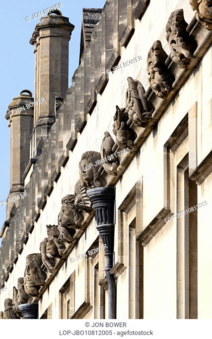 Array of gargoyles and exotics adorning the walls of Magdalen College in Oxford