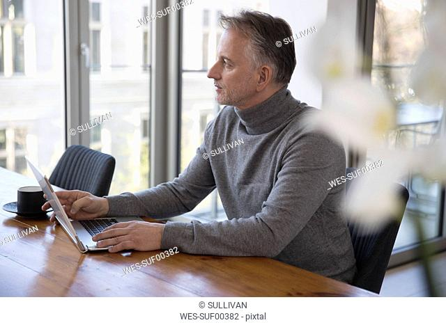 Businessman using laptop in conference room