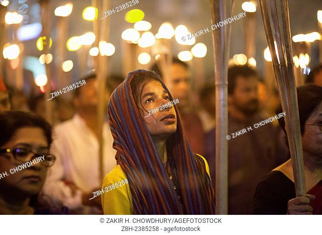 Dhaka, Bangladesh, Friday, February 27, 2015.Bangladeshi social activists shout slogans as they participate in a torch rally held to protest against the killing...
