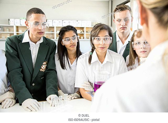 Students listening to teacher in lab
