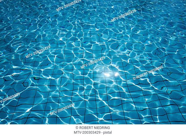 Sunlight reflected in swimming pool, Apulia, Italy