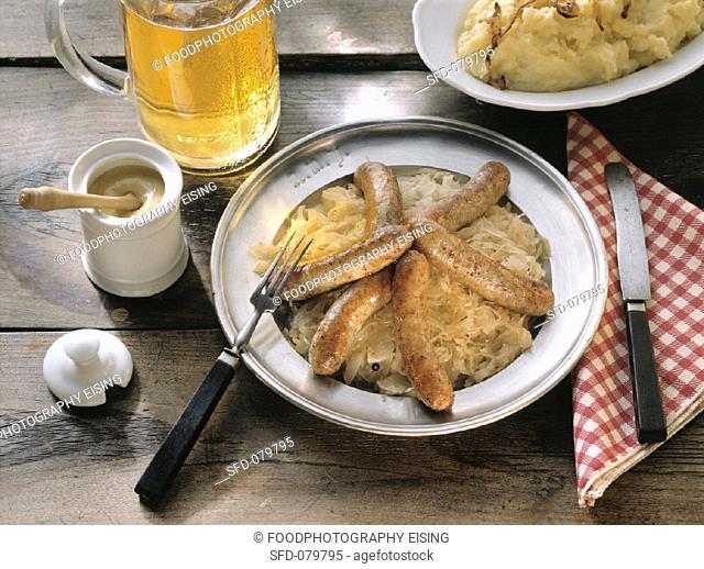 Grilled Sausages on Sauerkraut & Puree
