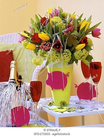 New Year's Eve arrangement of tulips and Viburnum