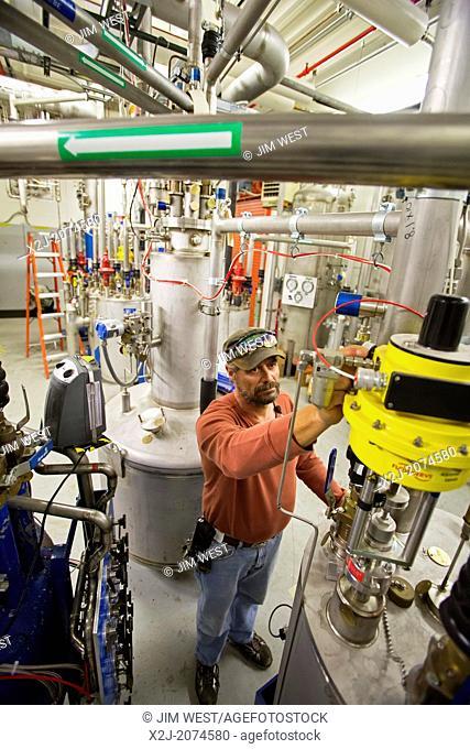 Batavia, Illinois - Cryotechnician runs equipment that provides liquid helium in the New Muon Lab at the Fermi National Accelerator Laboratory