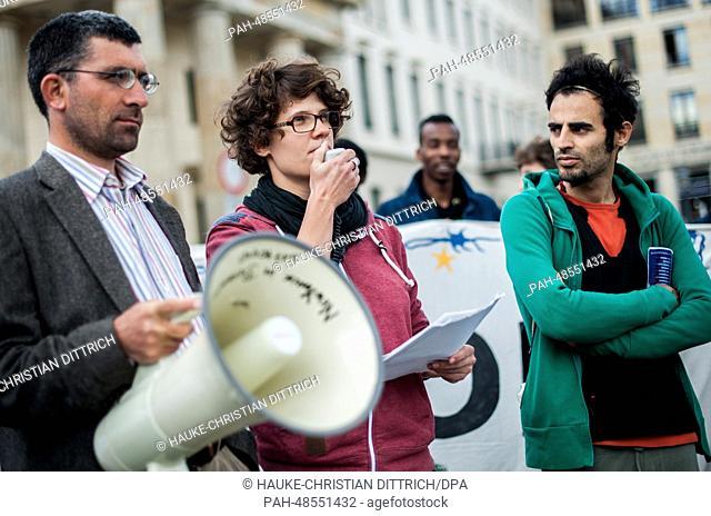 Refugees from Oranienplatz and activists of 'Blockupy Plattform Berlin' protest in front of Brandenburg Gate in Berlin, Germany, 13 May 2014