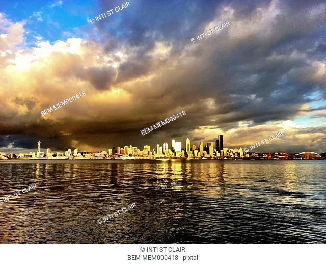 Dramatic clouds over city skyline, Seattle, Washington, United States