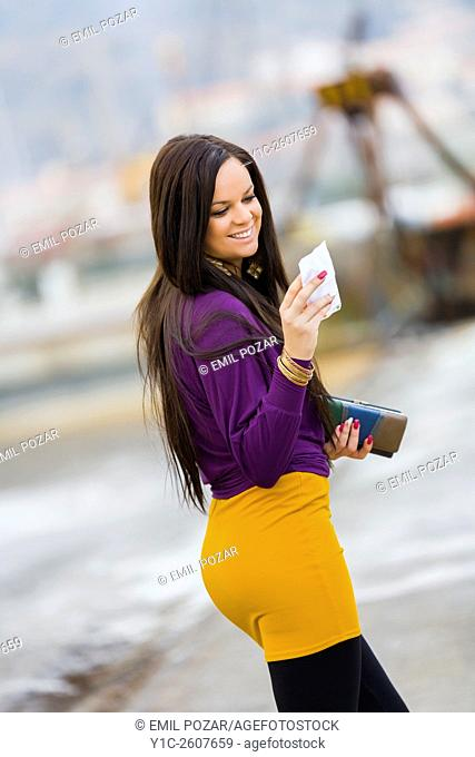 Young woman reading paper message is happy