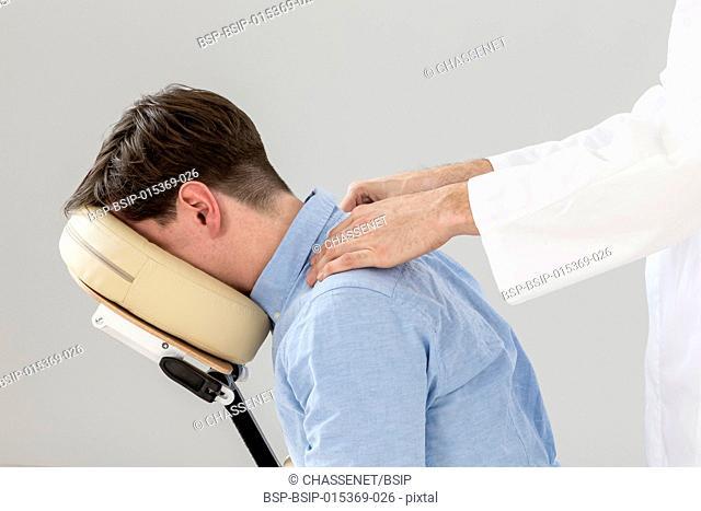 business Man having back massage in office