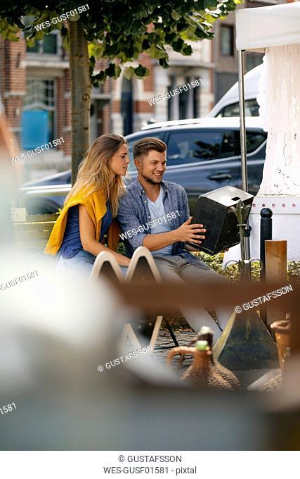 Belgium, Tongeren, young couple on an antique flea market