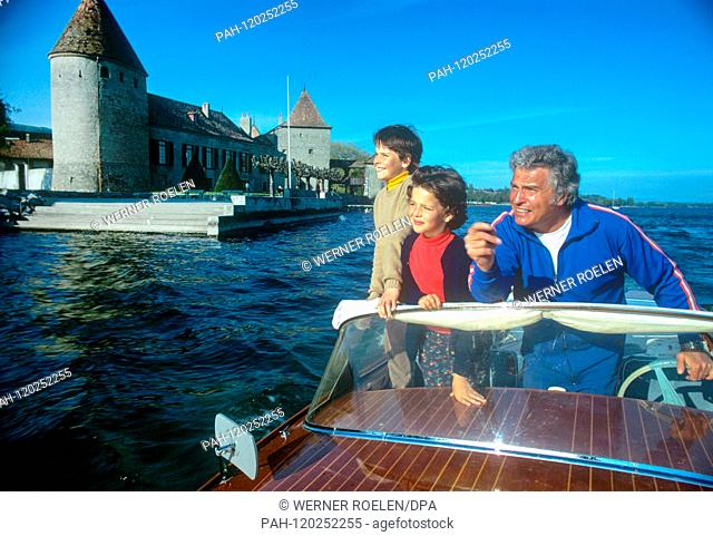 Husband Harald Schmid with the children Marc-Tell and Melisande on a boat trip near their home in Switzerland in the 1970s
