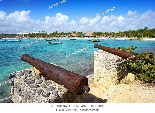 Akumal beach rusted iron canon in Riviera Maya of Mayan Mexico