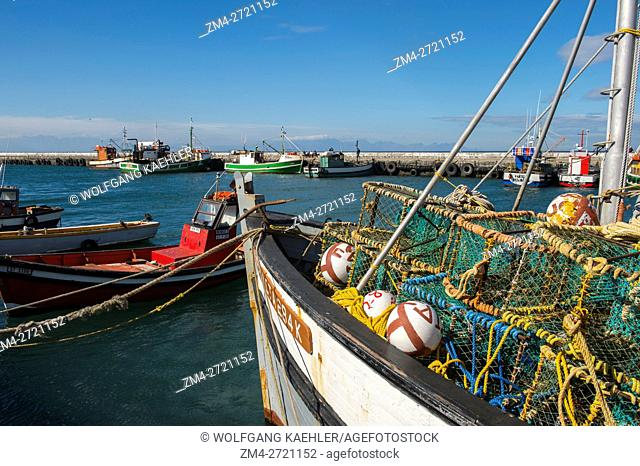 View of colorful fishing boats in the harbor of Kalk Bay near Cape Town, South Africa