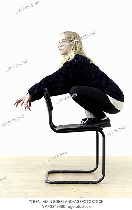 young thoughtful woman on chair, contrarian