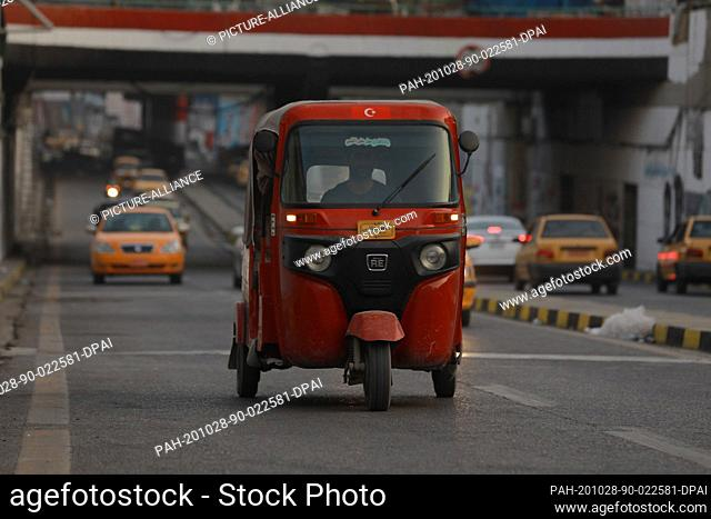 28 October 2020, Iraq, Baghdad: A Tuk Tuk passes through Tahrir Tunnel after security forces reopen roads leading to Tahrir Square