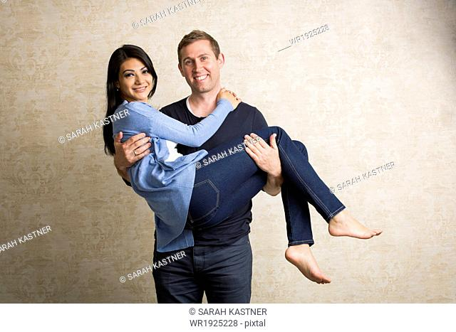 Man carrying woman in his arms