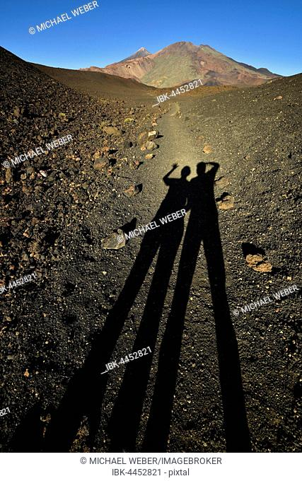 Shadows of two people, Pico del Teide and Pico Viejo, Teide National Park, Tenerife, Canary Islands, Spain