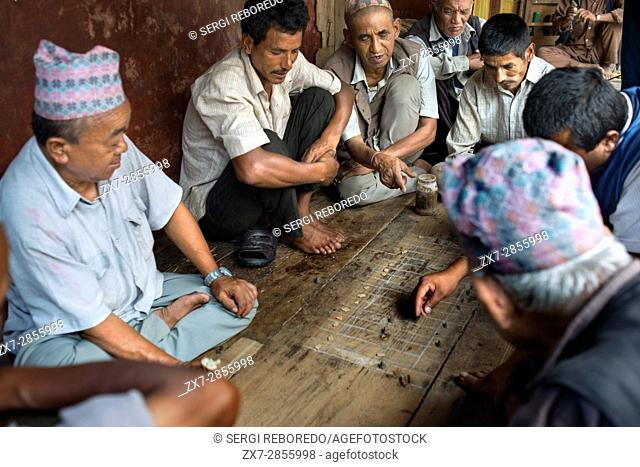 People playing Bagh-Chal game at Bhaktapur Durbar Square, Nepal. Bhaktapur listed as a World Heritage Site by UNESCO