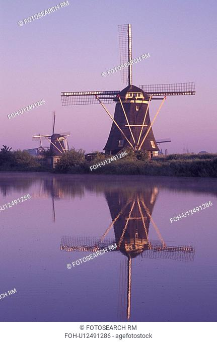 windmill, canal, Kinderdijk, Holland, Netherlands, Zuid-Holland, Europe, Mills of Kinderdijk, Working windmills along a canal in the early morning in Kinderdijk