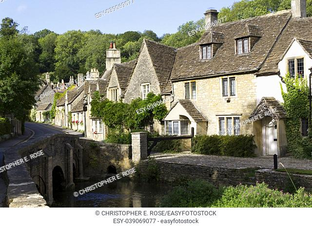 Quaint cotswold stone cottages in the village street, Castle Combe, Wiltshire, UK
