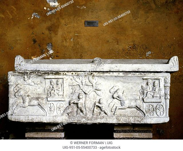 Relief on the side of a sarcophagus showing horses and chariots
