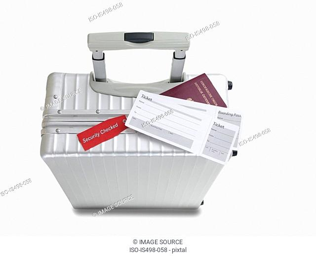 Suitcase airplane tickets and passport