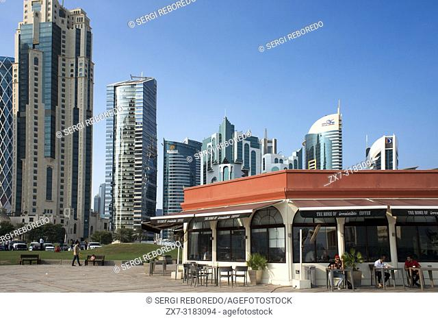 Costa coffee restaurant and modern skyline of the West Bay central financial district, Corniche promenade at Sheraton park Doha, Qatar, Middle East