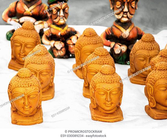 Buddha statues on sale at a fair