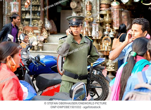 Nepal, Central Region, Kathmandu, order must be - pretty policewoman, orderly with the telephone has everything under control in the city district Tyauda in...