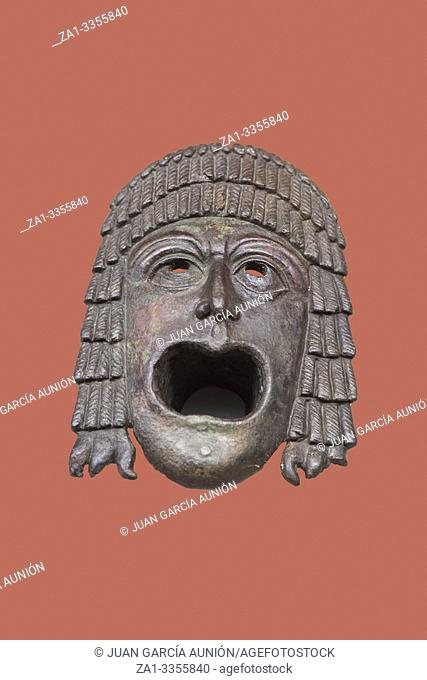 Theatre mask in bronze at National Museum of Roman Art in Merida, Spain. Isolated