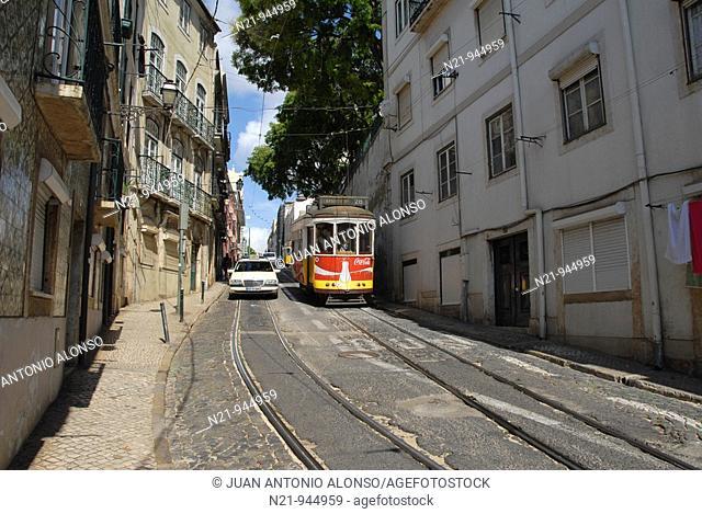 Trams and taxi on Calçada de Sao Vicente. Alfama, Lisbon, Portugal