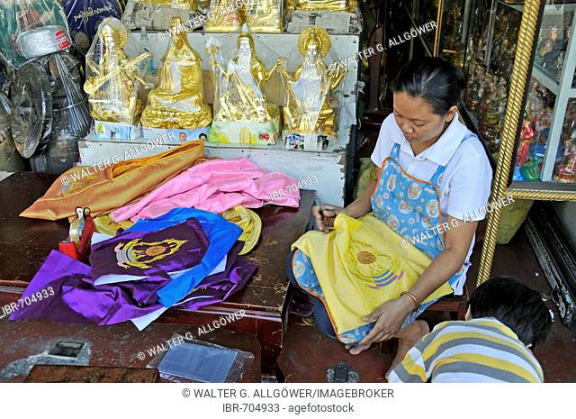 Buddha statues and other devotional objects for sale along Bamrung Muang Road, Bangkok, Thailand, Southeast Asia